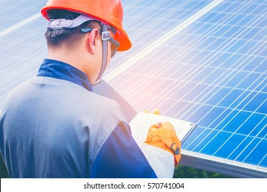 electrician working on checking equipment of operation plan in solar power plant