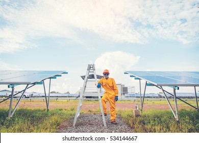 electrician working on checking and maintenance equipment at industry solar power;  employee cleaning solar panel