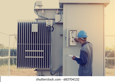 electrician working on checking status step up transformer high voltage on transformer yard and solution problem to operate at green energy solar power plant