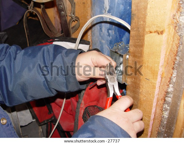 Electrician working on a light