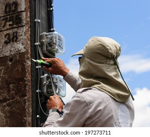 Electrician working on power poles