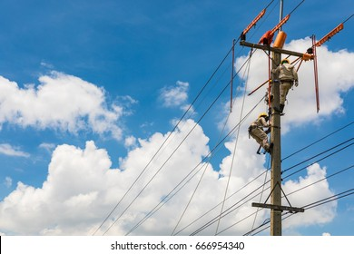Electrician works in the height.