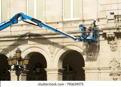 electricians in crane basket platform