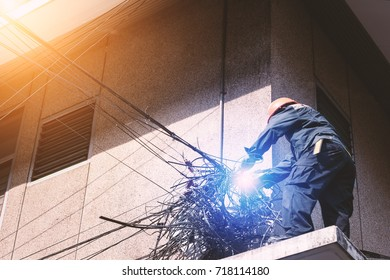 Electricians are dismantling the wiring from the building.The electrician made a bad mistake and was electrocuted.Electrical system development.Technician cutting cable.