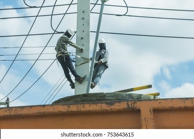 Electricians are installing power lines.