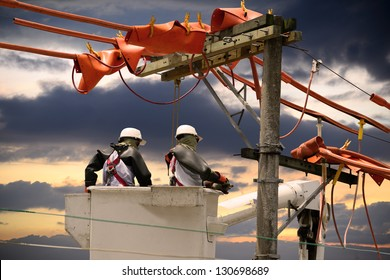 Electricians on a crane.