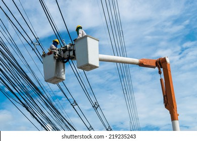 Electricians are Wiring Cable to install and repair power lines