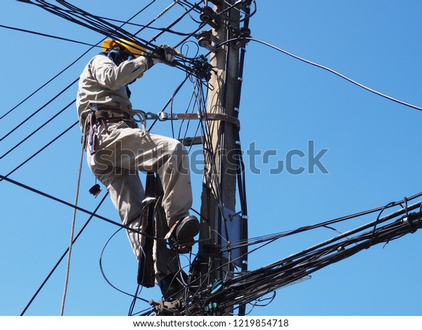Electricians Wiring On Top Power Poles People Stock Image 1219854718