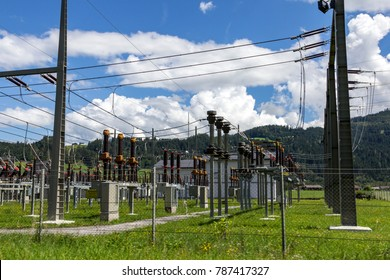 Electricity Authority Station, power plant, energy concept, blue sky with clouds, rural landscape, austrian alps