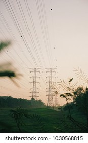 Electricity Cable Tower Power Supply with Sunrise & Fog