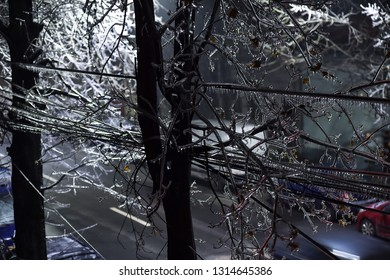 Electricity cables covered in ice after frozen rain phenomenon