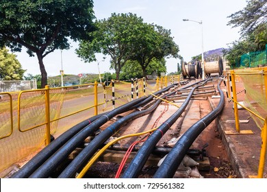 Electricity Cables Installation Trenches Electrical new high voltage power lines cables been installed in underground trenches along roads.