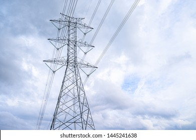 Electricity concept, Close up high voltage power lines station.  High voltage electric transmission pylon silhouetted  tower.