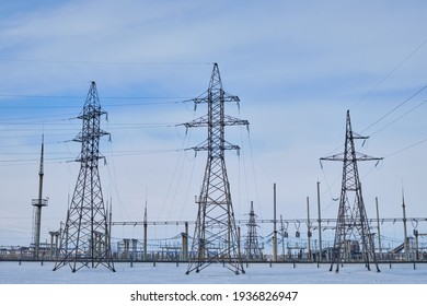 Electricity distribution supplying towers with sky background
