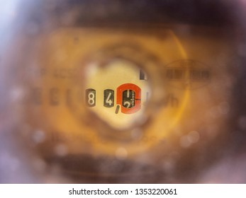electricity meter seen through a hole