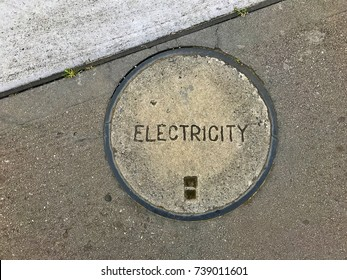 Electricity network access hatch cover in footpath