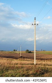 electricity poles in the field