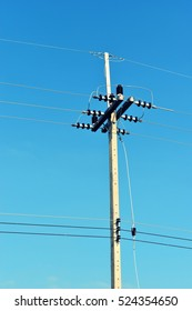Electricity poles at the roadside with beautiful blue sky