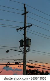 Electricity poles with sunset,silhouette Electricity cable communication towers on sunset