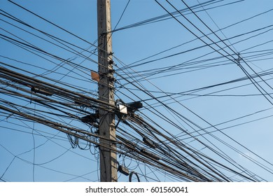 Electricity poles with wires, telephone lines, internet lines. And a lot of tangle.