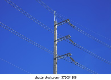 electricity post in blue sky