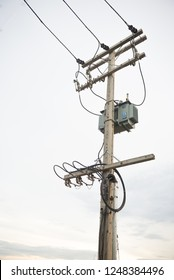 Electricity post with fuse and cable ,Electricity post and a white sky background. tranformer