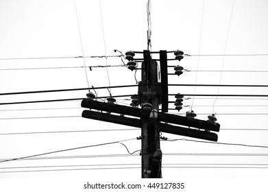Electricity post and others communication cables on black and white color