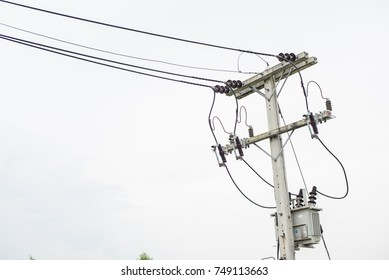 Electricity post and a white sky background. tranformer