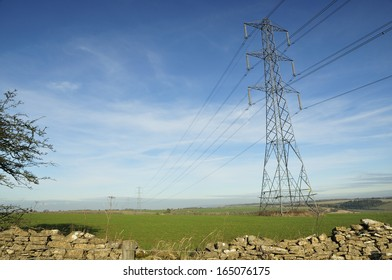 Electricity Power Lines cross Cotswold Farmland at Cleeve Common