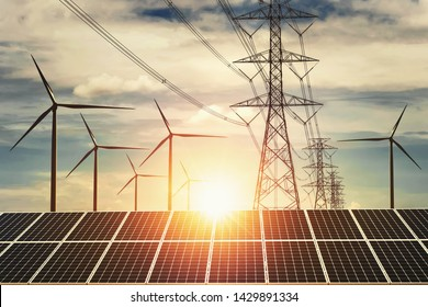 electricity power in nature. clean energy concept. solar panel with turbine and tower hight voltage sunset background