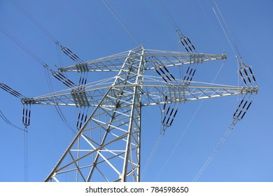 Electricity power transmission tower against blue sky