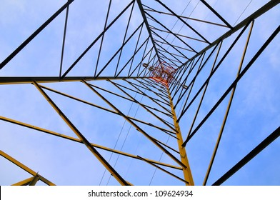 electricity pylon against blue sky bottom view, wide