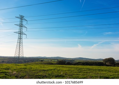 electricity pylon and cables in a field in Sardinia