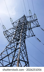 Electricity pylon, electrical transmission tower, against blue sky background. Energy power tower in Ukraine.