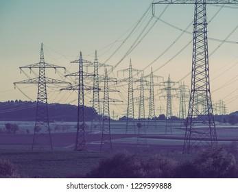 Electricity pylon in the field