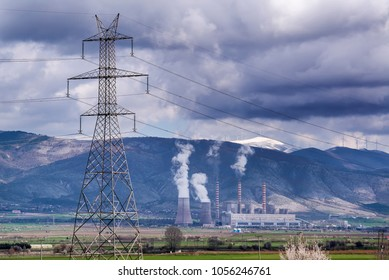 An electricity pylon with a Lignite Power Plant at the background, in northern Greece.