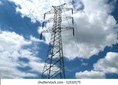 Electricity pylon on blue sky with clouds
