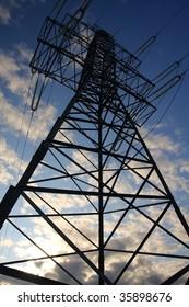 Electricity Pylon on sky background. Vertical composition.