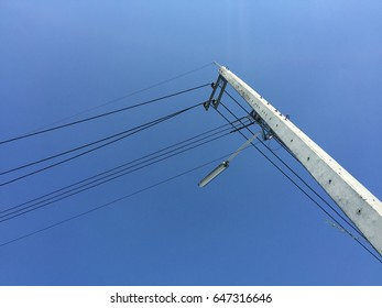 electricity pylon on a sunny day with a clear blue sky