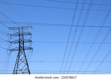 electricity pylon with power cable network against blue sky