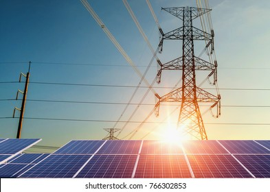 electricity pylon with solar panels and sunset. Clean power energy concept