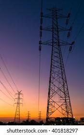 Electricity pylon at twilight.