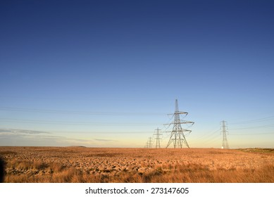 Electricity Pylons and clear blue sky, UK.