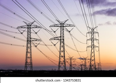Electricity pylons during dusk evening sky sunset.