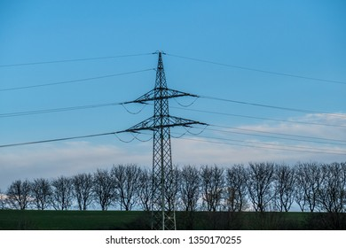 Electricity pylons in the field