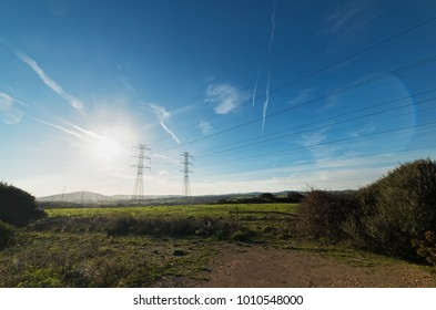 electricity pylons in a field in Sardinia, Italy