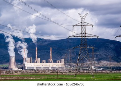 Electricity pylons with a Lignite Power Plant at the background, in northern Greece.