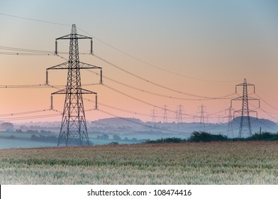 Electricity pylons and lines at dusk