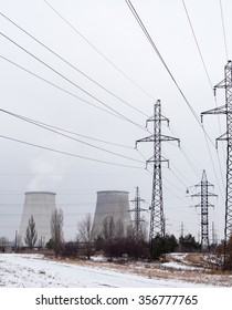 Electricity pylons, power lines and cooling towers of the cogeneration plant near Kyiv (Ukraine) in winter.