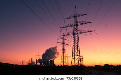 Electricity pylons and power plant in background
